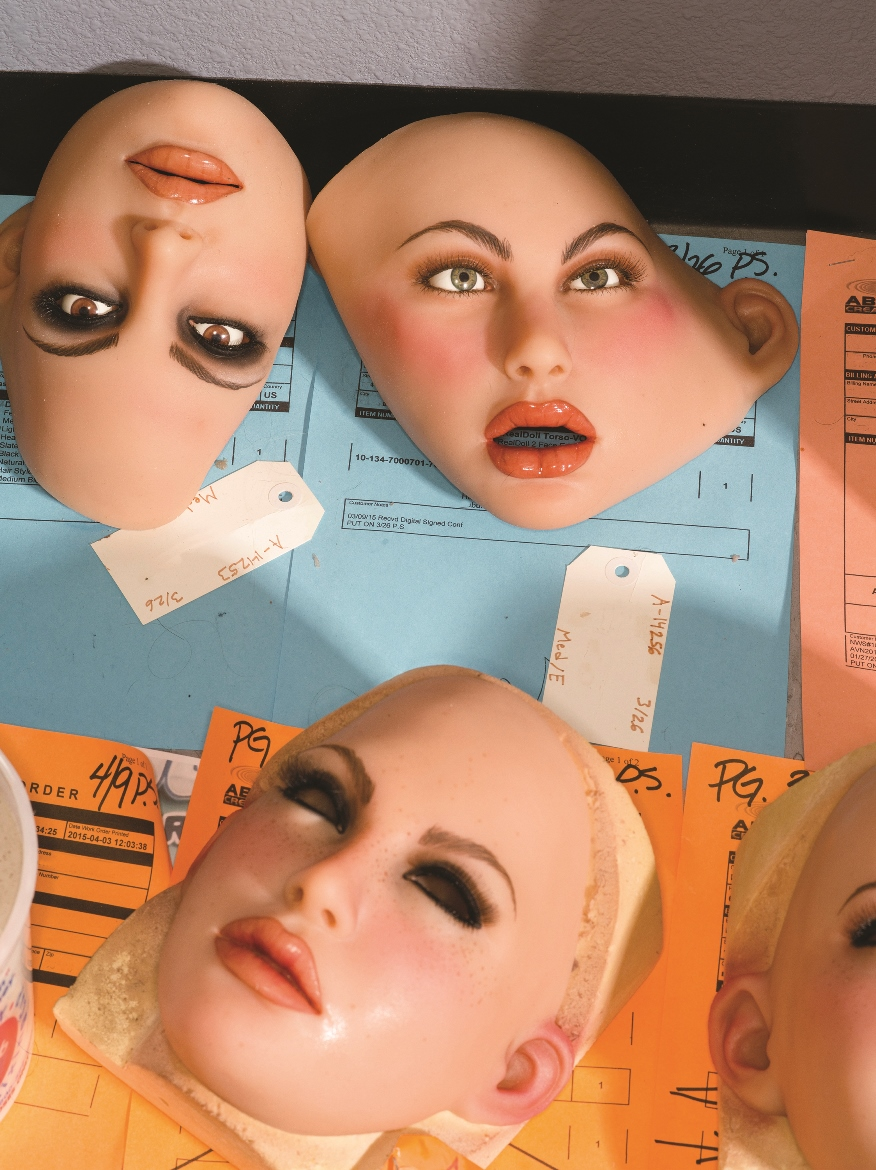 Love doll faces lie in various states of assembly at RealDoll, a company that manufactures life-size sex dolls in San Marcos, Ca. Some of the company's dolls have interchangeable faces, which fasten to the dolls head. Photo by Robert Benson.